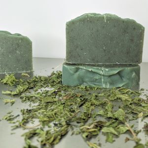 three bars of handmade vanilla mint soap with organic ingredients including stinging nettles and french green clay speckles of green in organic soap all natural ingredients