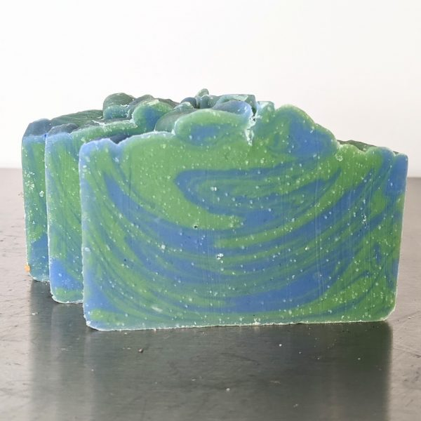 three bars of organic earth and water soap made with patchouli and kaffir lime essential oils a green and blue swirl made with in the pot swirl cold process soap method